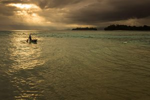 An outrigger canoe off Bougainville, Papua New Guinea.Credit...Georg Berg/Alamy
